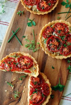 Tomato Tarts with cornmeal crust, manchego cheese and caramelized onions