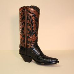 Lugus Mercury Black Alligator Belly Custom owboy Boot w Copper Kid Overlay - A custom cowboy boot of luxurious black alligator belly is topped with a black calf shaft that is overlayed with a handcut copper kid floral design. The boot is framed with a copper collar and copper lacing on the top. The pull straps are located on the inside so as not to detract from this gorgeous custom designed boot.