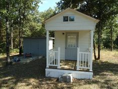 128-Square-Foot Home In Dover Arkansas This compact house on Utley Road hit the market on Yahoo's listings for an asking price of $23,000. And it has the most adorable teeny porch