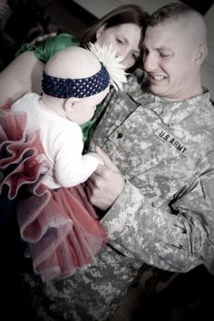 Soldier meeting his daughter for the first time. So sweet.