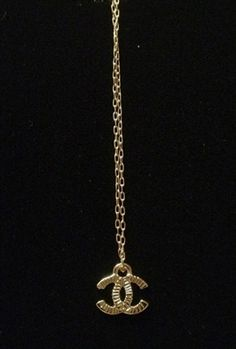 Kate Cummings Chanel Tiny Logo Necklace..I think I'm in LoVe.