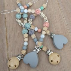 New pacifier clips