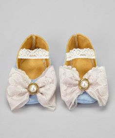 These enchanting flats almost look too decadent to wear. But trust us—once little ones put them on there's no turning back. With bow-topped toes, a soft sole and a secure elastic strap across the instep, this is one treat little feet won't want to miss.