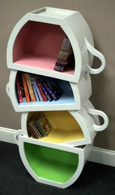 Tea cup bookshelf - neat for recipe books in a kitchen nook