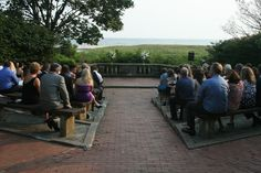 The Amphitheater at Harkness Memorial State Park is a popular place for wedding ceremonies.  Here the guests are relaxing, enjoying the natural beauty of the ocean.  The two vases of flowers add to the less-is-more feeling.  (You can't see me because I took the photo.  I'm not a professional photographer, and none of my photos ever see Photoshop!)
