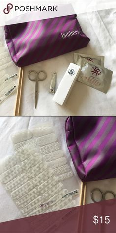 Jamberry Starter Kit Includes pouch, scissors, nail clipper, nail prep wipes, buffer, and two sheets of stickers (one sheet is full one is missing a set of stickers). Selling extremely cheap. Jamberry Other