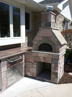 Planning your dream outdoor living space? A Chicago Brick Oven is a great addition to any outdoor kitchen space.
