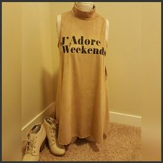J'Adore Weekends Sleeveless turtleneck shift, retro top. Loose fitting, very cute with leggings or jeans and booties. How will you wear it?  Made of polyester and spandex. Feels like suede. Made in L.A. Tops