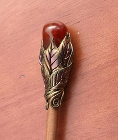 Hairstick with Orange/Red Polished Stone and Multi Gold Leaves and Vines.. $12.00, via Etsy.