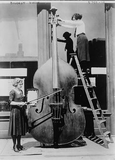 The page this links to gives no info on it, but by the looks of the women here, I think this giant bass actually plays!