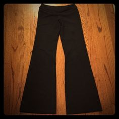 Black Lululemon Groove pants Black Lululemon Groove pants in size 4.  Made in their signature luon material.  Purchased this classic pair 5 years ago, before all of the quality / see thru issues.  Excellent condition.  Only worn a couple of times.  Wish I could fit them, but they have always been too small for me.  Finally willing to find them a new home! Pants lululemon athletica