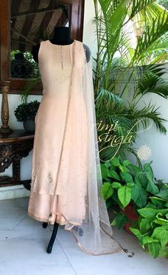 Where flowers bloom, so does hope... Nude pink chanderi kurta with sequin and dabka hand embroidery , teamed with a matching cotton silk palazzo and a net mukaish dupatta... Available exclusively at Rimi Singh Studio A 999 Sushant Lok 1 Gurgaon #9818310054