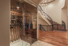 Glass-enclosed Wine Room adjacent to Formal Dining & Foyer