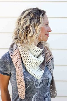 Toss on this modern crochet triangle scarf to head out to the desert, the mountains...or just the grocery store. This free Caron Cakes crochet pattern takes all the stress out of choosing colors because the skein does it for you! Perfect fall accessory. Color = Buttercream.