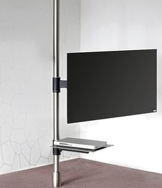 "TV Stand In this model, a stainless steel anchoring pivotal column provides the basis for a swiveling TV holder with concealed cable management. A TV set thus mounted can be swiveled using the extendable arm (2 axes of motion, up to 35 kg). For TV screens from 37"" to 60"". (for different TV sizes upon request)  Dimensions (h x w x d):      diameter of anchoring pivotal column; 6 cm (2,4"")     for use up to a ceiling clearance of 330 cm (129,9"")     swivel arm (version with 2 axes of motion)…"