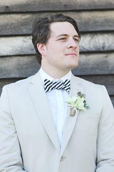 Cute groom! Photo: Loren Ioppolo