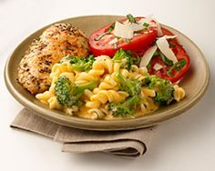 Italian Seasoned Chicken with Rotini & Broccoli with Cheese Sauce -   Preheat oven to 350°F. Combine oil, garlic and Italian seasoning in large bowl. Add chicken and turn to coat well. Cover and marinate in the refrigerator for 30 minutes.  Remove chicken from marinade and place in an oven safe baking pan; discard marinade. Bake in the preheated oven for 35 to 40 minutes or until chicken is no longer pink.
