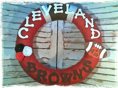 """Cleveland Browns Wreath.   14"""" yarn wrapped wreath with wood letters and felt flowers."""