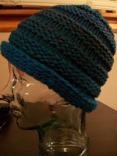 Deborah's Knifty Knitter Beanie  Crochet cast on, Row 1 knit, Row 2 Purl, Rows 3-6 Repeat rows 1-2 two times, roes 7-10 knit all, Rows 11-16 Repeat rows 1-6, Rows 17-19 Knit all BUT then I did about 3 sets of this to make the entire hat.