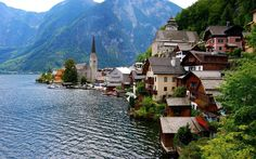 Hallstatt, Upper Austria, is a village in the Salzkammergut, a region in Austria. It is located near the Hallstätter See (a lake). At the 2001 census, it had 946 inhabitants. Alexander Scheutz has been mayor of Hallstatt since Austria, Places Around The World, Around The Worlds, Holland, Widescreen Wallpaper, Small Towns, Cool Places To Visit, The Great Outdoors, Beautiful Places