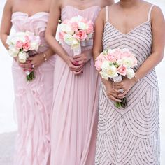 Coordinated colour but wearing their own style works for these bridesmaids in pink!