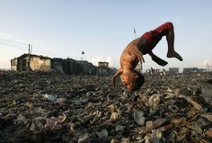 A boy plays at the garbage dump in Tondo, Manila, where hundreds of people make a living out of recycling waste into charcoal.