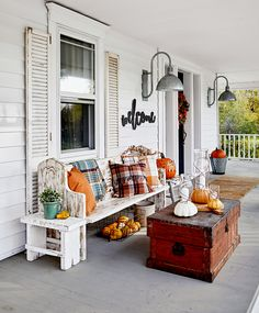 Add Seasonal Style to Your Home With These Fall Decorating Ideas Your exterior will be the talk of the neighborhood with this inviting mix of fall decorations. Front Porch Seating, Small Front Porches, Porch Table, A Table, Porch Decorating, Decorating Ideas, Decor Ideas, Fall Porch Decorations, Front Porch Fall Decor