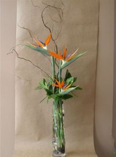 Tall glass bamboo vase with birds of paradise, curly willow branches, leaves and greenery The post Tall glass bamboo vase with birds of paradise, curly willow branches, leaves and& appeared first on Dekoration. Tropical Flowers, Tropical Flower Arrangements, Ikebana Flower Arrangement, Exotic Flowers, Flower Vases, Purple Flowers, Beautiful Bouquet Of Flowers, Home Flowers, Flowers Garden