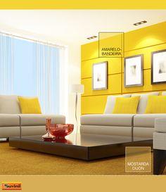 Uma parede decorativa na cor Amarelo-bandeira trouxe energia e vivacidade para essa sala de estar, mantendo uma decoração sóbria. Na #PaletaSuvinil: #AmareloBandeira e #MostardaDijon