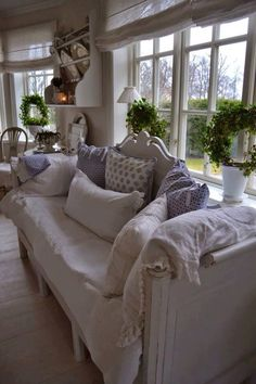 Lovely lavender and warm white shabby chic decor with a modern touch of greenery