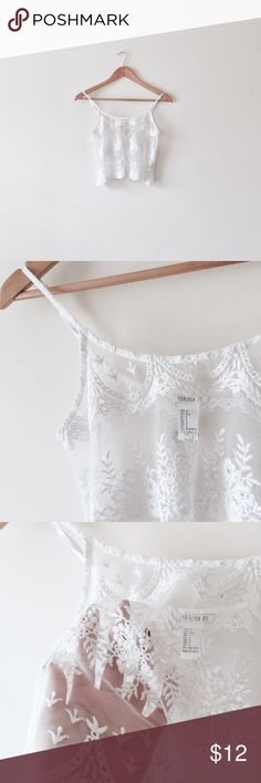 White sheer lace crop cami Size S. Sheer, lacey, cropped length, adjustable straps. Same style in nude color also available in my closet. Forever 21 Tops Camisoles