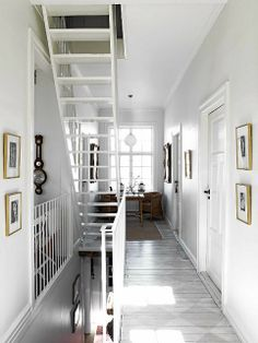 "Love the neutral walls and the little ""moment"" they created at the end of the hallway. Great example of a well decorated small, narrow space."