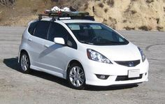 Yakima roof rack with snowboards for the Honda Fit! @Rachel Turner this is my Christmas list ❤️❤️❤️