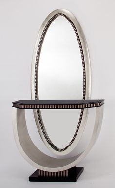 """Large oversized oval mirror in silver leaf with accents of dark brown/black Handmade 32x2x80"""" Also available: Console Table - $1069.00"""