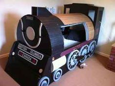 Kid's train bed... comes with train station dresser and water tower bookcase.  Way too cute!!