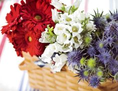 Red Gerbera Daisies, White Campanula and Blue Thistle in a Warm Brown Medium Market Basket