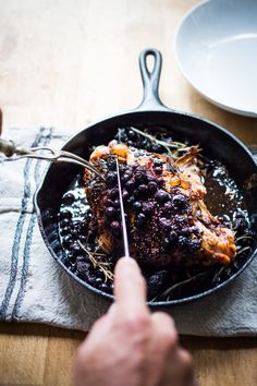 A delicious recipe for Roasted Turkey Breast with Blueberry Balsamic Glaze with whole grain mustard, dried figs, roasted blueberries and fresh rosemary sprigs.   www.feastingathome.com