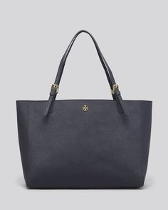 Luxurious saffiano leather adds dimension to a work-to-weekend tote by Tory Burch. | Saffiano leather; lining: logo-print polyester | Imported | Double leather handles | Open top | Padded interior cen