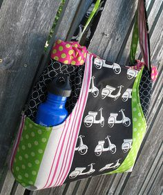 Scootn' Around Town Tote. $12 pattern.  She says she used fusible fleece on the outer piece and decor bond on the inner.