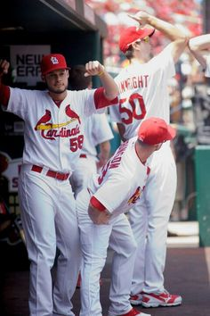 Jose Martinez (58), Shane Robinson (43) and Adam Wainwright (50) having fun in the Dugout.