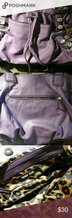 Super Fun Penny Sue Antwerp Handbag/Purse Super cute dusky purple purse with silver hardware and sparkly gem embelishments!  This bag is super slouchy, squishy, and soft.  Magnetic closure with pulls that cinch for more security.  Open and nice sized pocket on the front and a zipper pocket on the back.  Inside has two open pockets and one zippered.  The inside is decked out in a satin cheetah print.  RAWR!  Tag states 100% PVC Body/Trim100%Polyester Lining No rips, tears, stains, or missing…