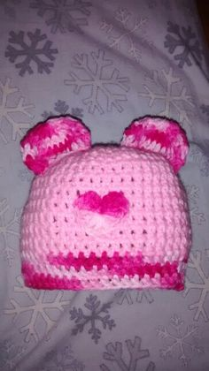 Crochet hat with ears, change colors to look like mickey or minnie or add buttons for bear eyes.