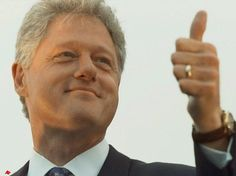 Bill Clinton giving the thumbs up to one of his gal-pals while wearing the omni-present wedding ring. He and Bill Cosby should do a road show and compare notes….so to speak.