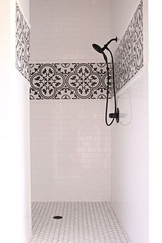 Love the simplicity of this master bath design. Not too trendy but like the black and white touch in the shower