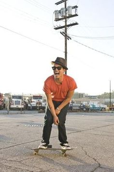 Bruno Mars - photo  On a skateboard in an awesome hat