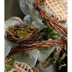 Moss adds a realistic touch to this man made 3-inch Angel Vine  Bird Nest
