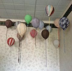 Fabric Balloons: We always have a lot of scrap fabric on hand (who'd have thought?) and decided to cut some of it into strips and then wrap around balloons using paper mache.