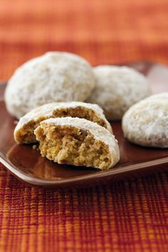 Pumpkin Snowballs Pumpkin and sugar cookie dough rolled up with pecans and sugar.