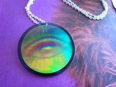 Eye Hologram Monocle Necklace by glowwormshop on Etsy, $19.50. Remember these?
