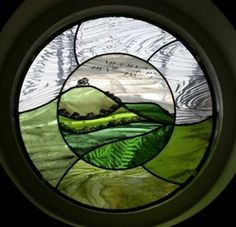 I think this is Annie Rie; love the subject (hills) and circular shape Modern Stained Glass, Stained Glass Paint, Stained Glass Designs, Stained Glass Panels, Stained Glass Projects, Stained Glass Patterns, Leaded Glass, Mosaic Glass, Window Glass